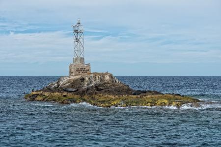abandoned lighthouse on small rocks island