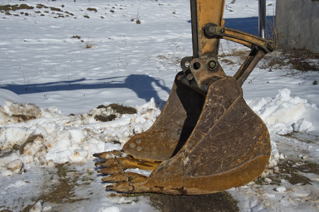caterpillar escavator hard used rusted bucket photo