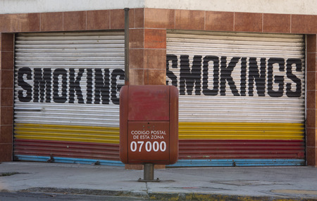 smokings sign shop in mexico city photo