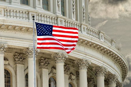 Washington DC Capitol dome detail with waving american flag 스톡 콘텐츠