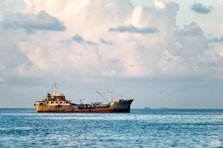 ship wreck: ship wreck in maldives sand reef Stock Photo