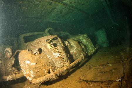 ship wreck: Old Car inside II world war ship wreck hold