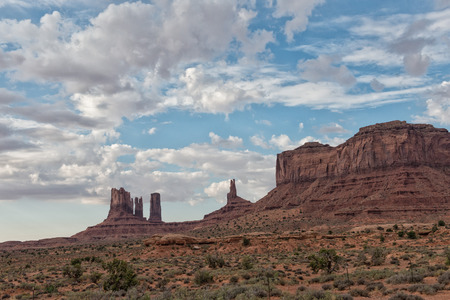 valley view: Monument Valley view at sunset with wonderful cloudy sky and lights on mittens