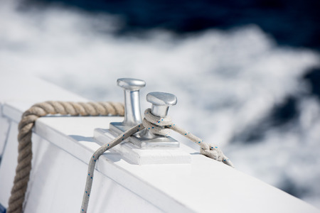 bollard: boat bollard detail on blue sea background