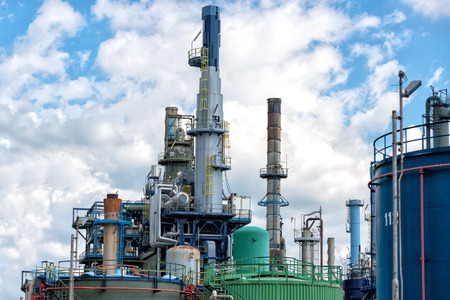 gas plant: oil refinery on blue sky cloudy background