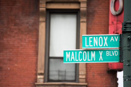 green new york street sign: Malcom X and Lenox