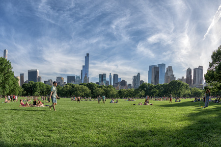 NEW YORK - USA - 14 JUNE 2015 people is spending time amusing in central park on sunny sunday