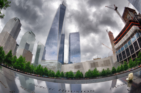 national historic site: NEW YORK - USA - 13 JUNE 2015 people near freedom tower and 911 memorial Editorial