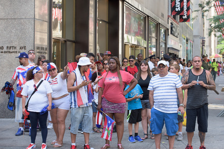 marchers: NEW YORK CITY - JUNE 14 2015: Annual Puerto Rico Day Parade filled 5th Avenue with some 80,000 marchers & more than one million spectators Editorial