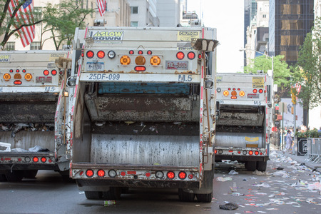 marchers: NEW YORK CITY - JUNE 14 2015: Trucks are cleaning the street after Annual Puerto Rico Day Parade that filled 5th Avenue with some 80,000 marchers & more than one million spectators Editorial