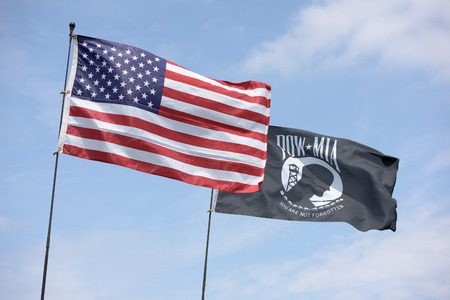 pow: American flag along with the POW MIA flag