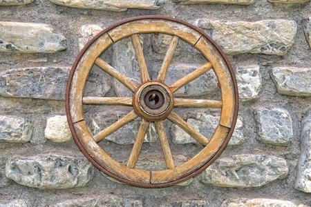 far: Far west wagon wheel isolated on wall