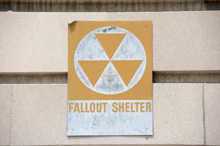 fallout: yellow fallout shelter sign on a building