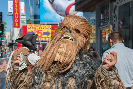 fame: LOS ANGELES, USA - AUGUST 1, 2014 - people and movie mask on  LA Hollywood Walk of Fame