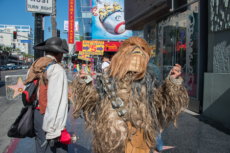 walk of fame: LOS ANGELES, USA - AUGUST 1, 2014 - people and movie mask on  LA Hollywood Walk of Fame