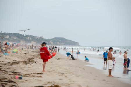 zuma: LOS ANGELES, USA - AUGUST 3, 2014 - people on Zuma sandy  beach in summer time Editorial