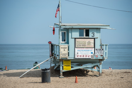 baywatch: LOS ANGELES, USA - AUGUST 5, 2014 - people in venice beach landscape and baywatch tower in los angeles Editorial