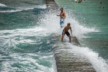 honolulu: HONOLULU, USA - People having fun at waikiki beach in Hawaii Oahu island Editorial