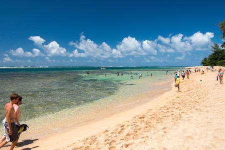 honolulu: HONOLULU, USA - AUGUST, 14 2014 -  People having fun at hawaii island beach
