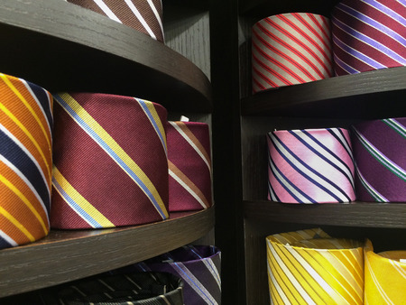 silk tie: different colors silk tie on display stand
