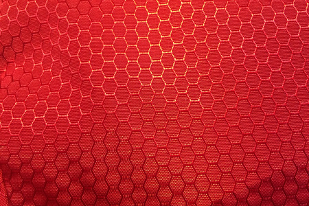 synthetic: red hexagonal synthetic pattern fabric background