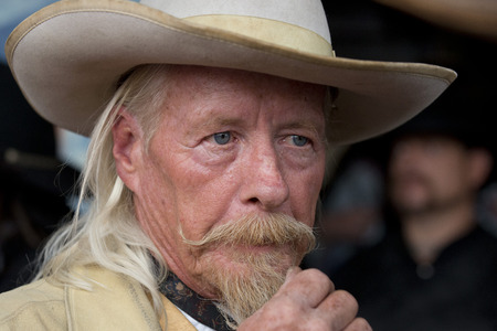 western usa: CODY - USA - AUGUST 21, 2012 - Western Gunfight in the Streets of Cody, Wyoming Editorial