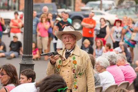 annie: CODY - USA - AUGUST 21, 2012 - Western Gunfight in the Streets of Cody, Wyoming Editorial