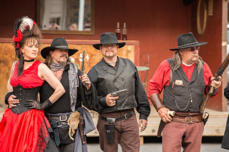 outlaws: CODY - USA - AUGUST 21, 2012 - Western Gunfight in the Streets of Cody, Wyoming Editorial