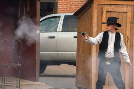 cody: CODY - USA - AUGUST 21, 2012 - Western Gunfight in the Streets of Cody, Wyoming Editorial