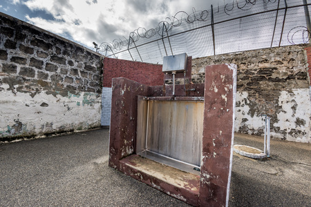 building external: PERTH - AUSTRALIA - AUGUST, 20 2015 - Fremantle Prison was constructed as a prison for convicts and more than 50 people were hanged inside the building. External pissoir Editorial