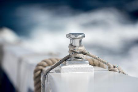 bollard: boat ship bollard detail on blue sea background