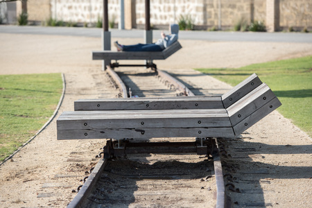 solid wooden chaise longue on rail tracks