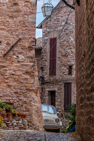 spello: vintage old car in spello medieval village in Tuscany
