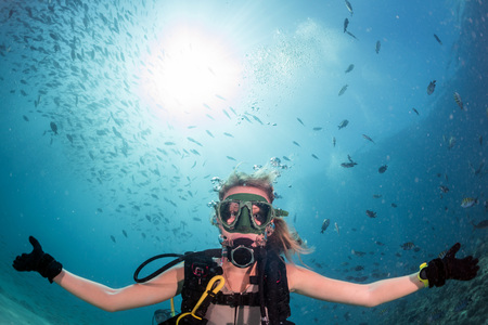 deep blue: beautiful diver blonde girl diving in the deep blue sea Stock Photo