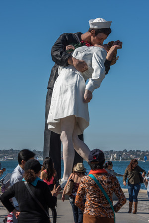 vj: SAN DIEGO, USA - NOVEMBER 14, 2015 - People while taking pictures at Unconditional Surrender sailor and nurse statue san diego.  A sculpture by Seward Johnson resembling a photograph by Alfred Eisenstaedt, V-J day in Times Square, but said by Johnson to b