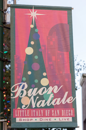 italian people: SAN DIEGO , USA-  DECEMBER 4, 2015 -  Merry xmas sign in Little Italy - San Diego, traditonal celebration of italian people living in USA Stock Photo