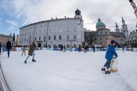 december 31: SALZBURG, AUSTRIA - DECEMBER 31, 2015 - People skating in town place