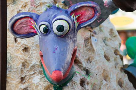 papier mache: VIAREGGIO, ITALY - FEBRUARY 17, 2013 - Carnival Show parade on town street with traditional Burlamacco Pulcinella style mask and wagon papier mache stone faced parade