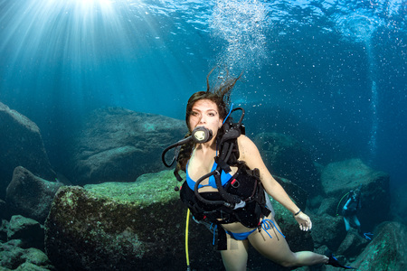 Black hair young and pretty mexican latina Scuba diver without mask