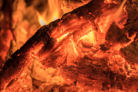 fire place: red hot wood embers detail in fire place
