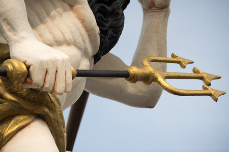 deck cannon: gold statues on pirate sail ship detail