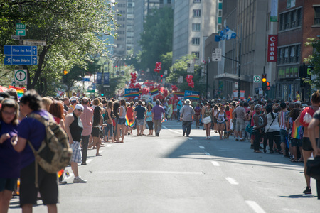 sexual orientation: MONTREAL, CANADA - AUGUST, 18 2013 - Gay Pride parade on town street
