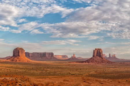 monument valley view: Monument Valley view with wonderful cloudy sky and lights on mittens Stock Photo
