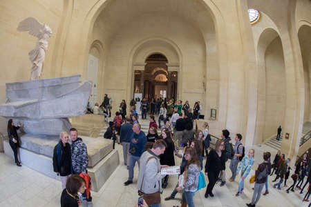 leonardo davinci: PARIS, FRANCE - APRIL 30, 2016 - Louvre museum crowded of tourist taking pictures of painting and statue