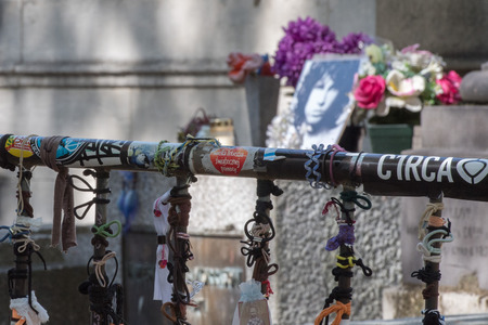 morrison: PARIS, FRANCE - MAY 2, 2016: Jim Morrison grave in Pere-Lachaise cemetery, Paris. Each year thousands fans and curious visitors come to pay homage to Jim Morrisons grave