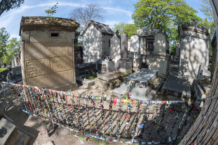 jim: PARIS, FRANCE - MAY 2, 2016: Jim Morrison grave in Pere-Lachaise cemetery, Paris. Each year thousands fans and curious visitors come to pay homage to Jim Morrisons grave