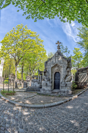 homage: PARIS, FRANCE - MAY 2, 2016: Monumental  Pere-Lachaise cemetery, Paris. Each year thousands fans and curious visitors come to pay homage to celebrities grave Editorial