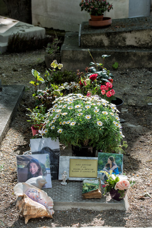 the celebrities: PARIS, FRANCE - MAY 2, 2016: Monumental  Pere-Lachaise cemetery, Paris. Each year thousands fans and curious visitors come to pay homage to celebrities grave. Susan Garrigues was killed by terrorist in bataclan attack of 13 november 2015 Editorial