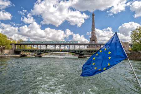 european community: paris cityscape old houses landscape huge panorama view from seine river boat with european community waving flag