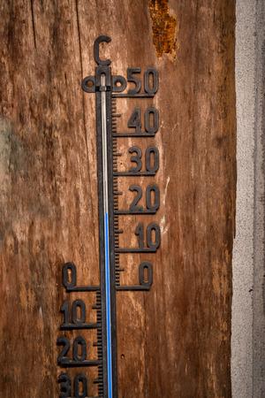 Vintage thermometer celsius 20 degrees blue level detail close up mercury
